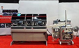 assembly machine and packaging equipment for diagnostic test kits